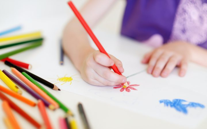 Canva Cute Girl Drawing a Picture with Colorful Pencils in Arabic