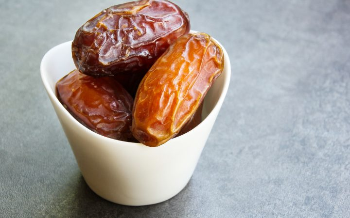 Canva Dried Date Fruit Healthy Snack Close up in Arabic
